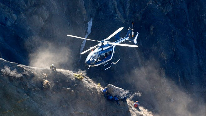 Search workers are deployed by helicopter at the crash site of the Germanwings Airbus A320.