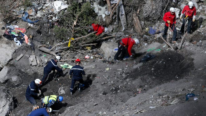 Workers collect debris and search for the second black box at the crash site of the Germanwings Airbus A320 in the French Alps, above the town of Seyne-les-Alpes, in southeastern France, on March 29, 2015