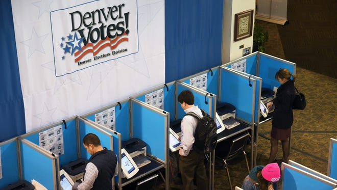 Voting in Denver in 2016.