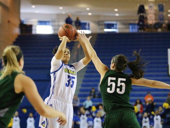 Delaware's Alison Lewis shoots in front Loyola forward