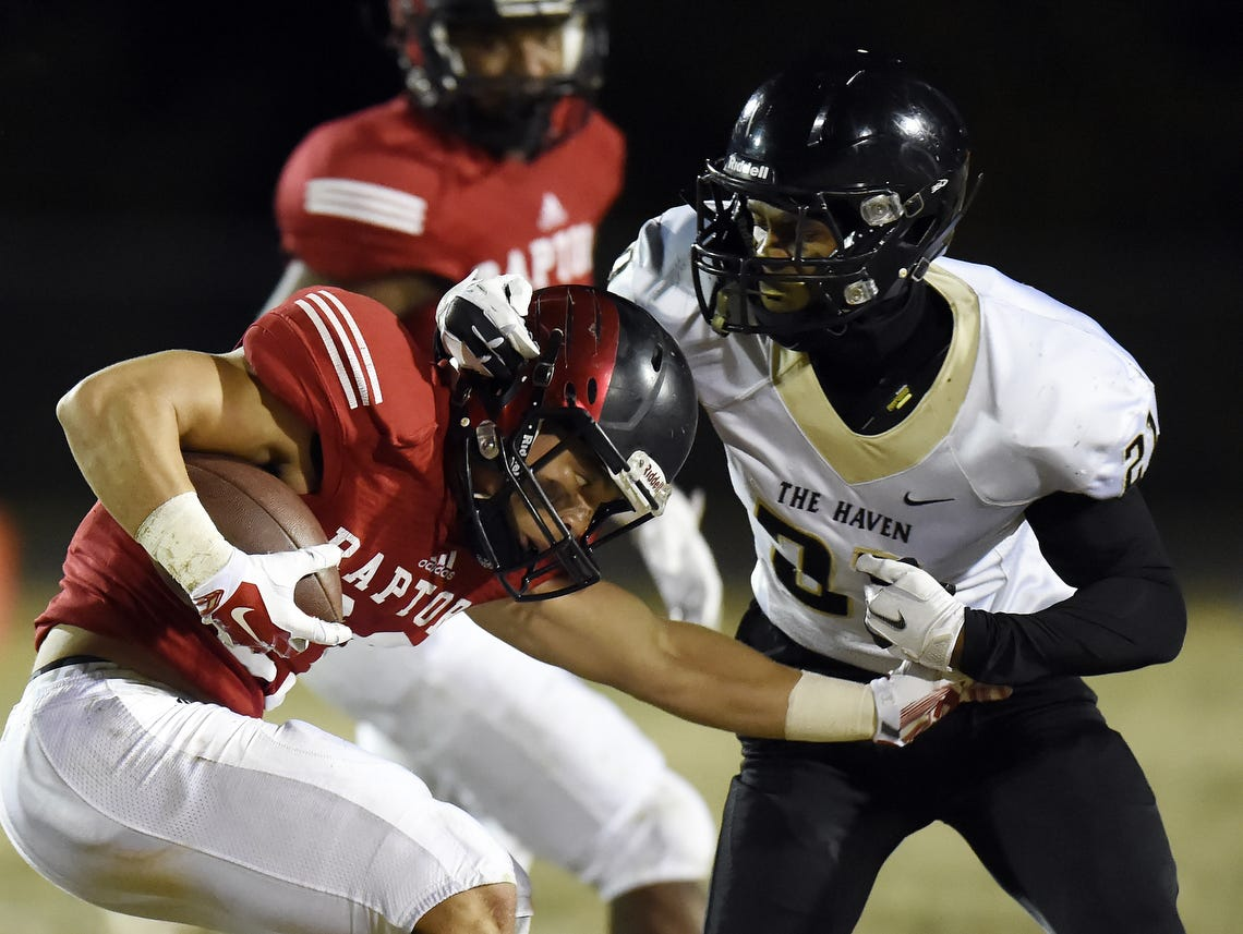 Ravenwood's Chris Rowland (left) tries to break free from a Whitehaven defender during last week's win.