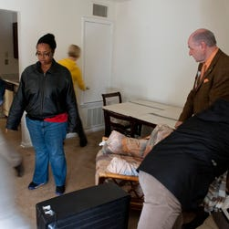 Tchernavia Montgomery, Director, Behavioral Health, Carolinas Healthcare System, gives Jessica duCille a hug on moving day. Jessica was moving from temporary housing into her own apartment.