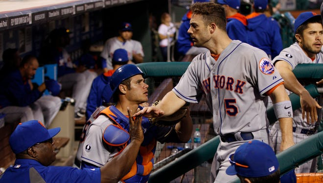 David Wright returns to the dugout after his go-ahead single in the 14th inning.
