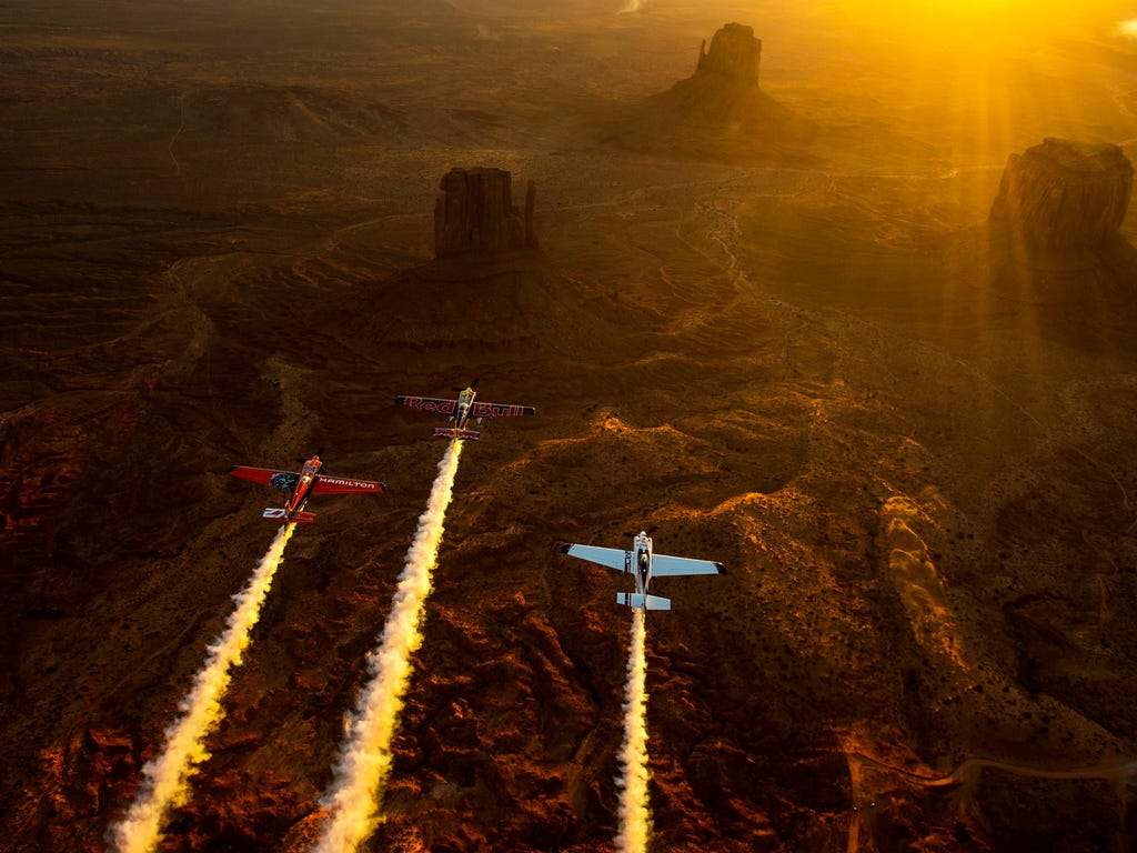 Kirby Chambliss, Nicolas Ivanoff and Matthias Dolderer fly over the Monument Valley Navajo Tribal Park in Utah as the three pilots ferry their race planes to the season finale of the Red Bull Air Race World Championship held in Las Vegas.
