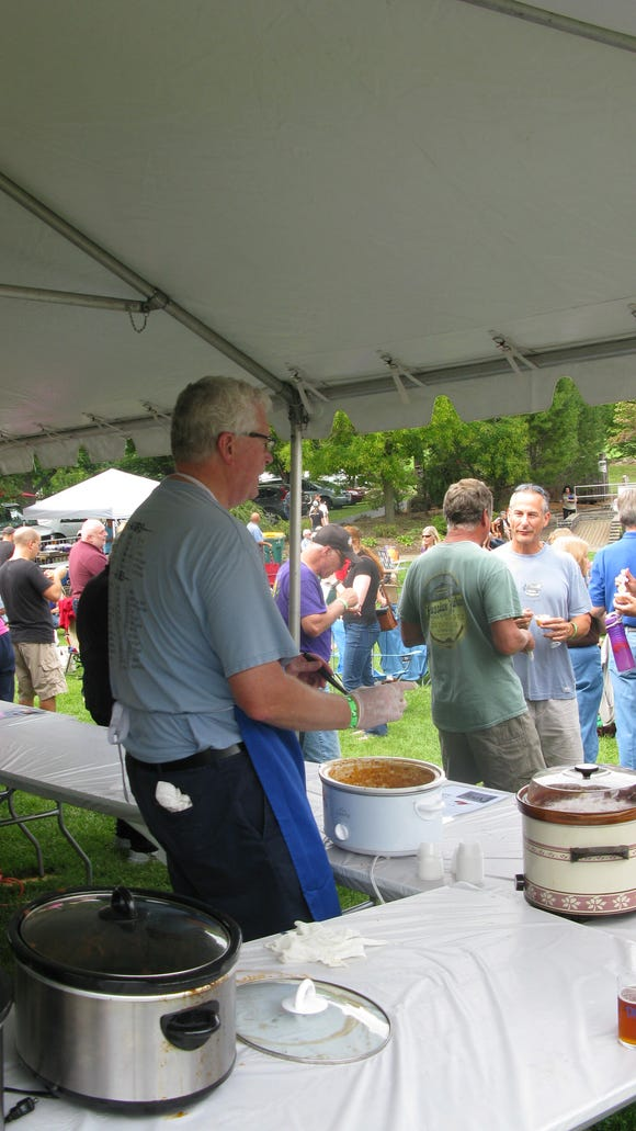"""Penfield Supervisor, Tony LaFountain, was one of the competing chili cooks at Penfield's """"Tastin' the Blues Chili"""" event."""