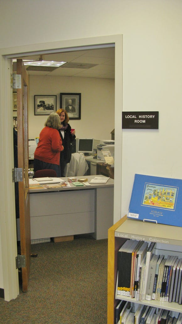 Penfield Town Historian, Kathy Kanauer (in red sweater) is shown talking to a visitor at the Local History Room Open House. Visitors with memories of early kitchen equipment were invited to speak about what it was like to make dinner before microwave ovens, garbage disposers, dishwashers and automatic ice makers in the refrigerator.