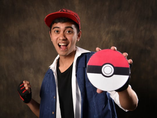 PDN producer John Borja prepares to catch them all, dressed as Pokemon's Ash character on Oct. 21.