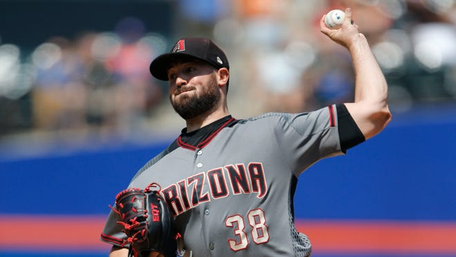 Aug 24, 2017: Arizona Diamondbacks starting pitcher Robbie Ray (38) pitches in the first inning against the New York Mets at Citi Field.