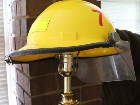 A helmet affixed with No. 7 served as a lampshade near