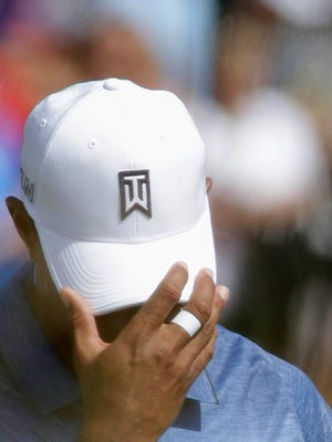 Tiger Woods holds his hat as he walks on the first hole fairway at the PGA Championship Thursday, Aug. 13, at Whistling Straits near Haven.