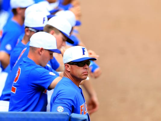 FILE - In this June 12, 2017, file photo, Florida head coach Kevin O'Sullivan watches from the dugout during an NCAA college super regional baseball game against Wake Forest in Gainesville, Fla. Florida is No. 1 in every major preseason poll, and for good reason. Coach Kevin O'Sullivan returns five starters and most of the nation's best pitching staff. (AP Photo/Matt Stamey, File)