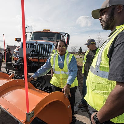 Snow plow drivers Annette Lowe and Earl Casey talk