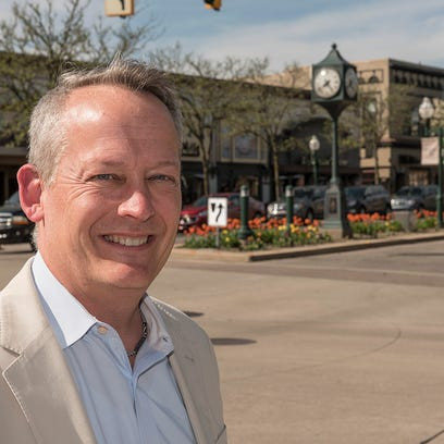 Mayor Dan Dwyer stands in the downtown of a city he