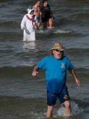 Despite Monday's near freezing temperature merrymakers of all ages celebrate the new year with a dip into Santa Rosa Sound during Paradise Bar and Grill's annual Polar Bear Plunge on New Year's Day 2018.