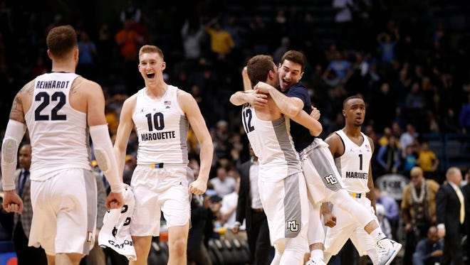 Marquette teammates celebrate an over time victory over Seton Hall on Wednesday night.