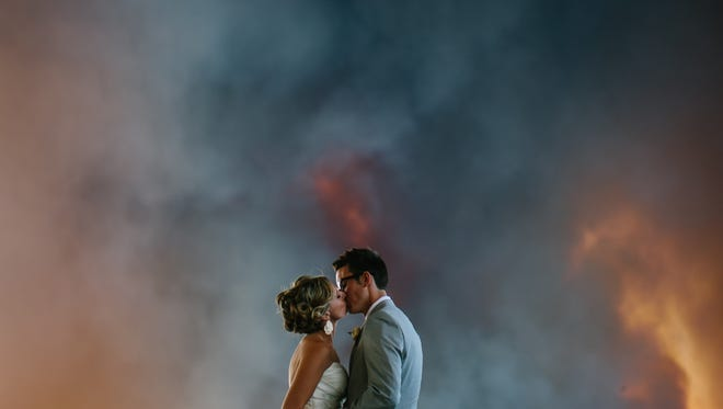 Photographer Josh Newton captured portraits of bride April Hartley and groom Michael Wolber as a wildfire forced their wedding guests to be evacuated from their ceremony site.