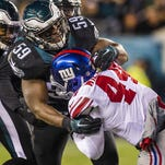 Eagles linebacker DeMeco Ryans tackles the Giants' Andre Williams on Oct. 19. Ryans missed the next two games with a hamstring injury.
