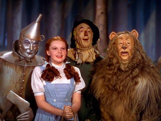 Jack Haley, left, Judy Garland, Ray Bolger and Bert