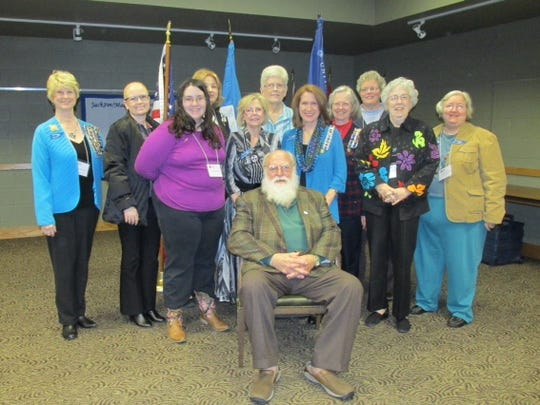 Vietnam veteran John Singleton, seated, spoke at the Jackson-Madison chapter of the National Society of Daughters of the American Revolution meeting Nov. 20. From left to right: Jackie Utley, Jennifer Rowan, Virginia Bates, Mandy Williams, Debbie Bosten, Marianna Warmath-Lewis, Alice Holtin, Gwen McReynolds, Beverly Dutcher and Linda Higgins.