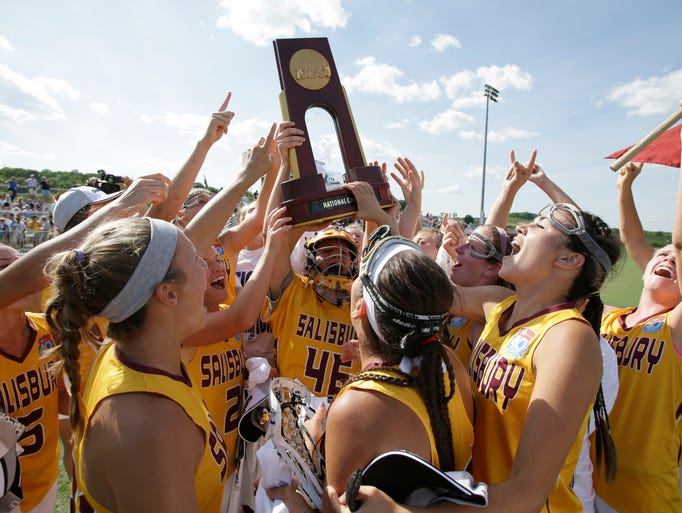 GETTYSBURG,PA--May 25, 2014- Members  of the Salisbury University Sea Gulls  celebrate with the National Championship trophy after beating Trinity 9-6 to win their NCAA National Championship game in Gettysburg, Pa.(Salisbury Daily Times photo by Christopher Gardner)