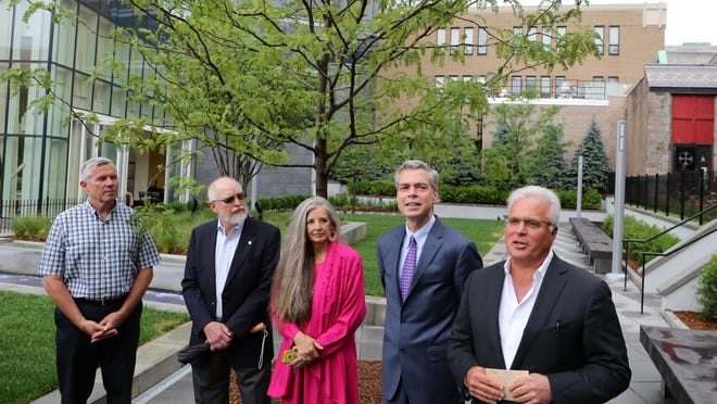 Louis Cappelli, right, president of the Cappelli Organization, joined by Mayor Tom Roach and members of the Common Council, speaks at the dedication ceremony for the park on Main Street in White Plains July 9, 2015. The park is the last part of the Cappelli Organization's redevelopment of the downtown area. The 11,000-square foot park is the first privately owned park with public access in the county.