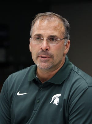 In this Aug. 4, 2014, file photo, Michigan State defensive coordinator Pat Narduzzi talks to the media during the team's NCAA college football media day in East Lansing.
