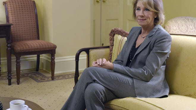 Betsy DeVos, President-elect Donald Trump's nominee for Education Secretary, sits with Senate Majority Leader Mitch McConnell of Ky., before the start of their meeting on Capitol Hill in Washington, Thursday, Dec. 1, 2016. (AP Photo/Susan Walsh)
