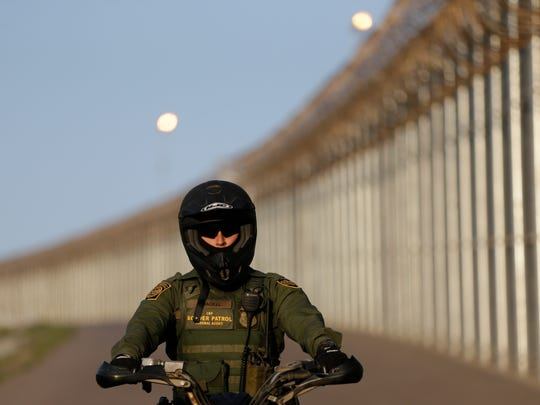 In this June 22, 2016 photo, a Border Patrol agent rides a vehicle along a border structure in San Diego. Lawmakers, union leaders and polygraph experts contend that the use of lie detectors in the application process has gone awry and that many candidates are being subjected to unusually long and hostile interrogations, which some say can make people look deceptive even when they are telling the truth.