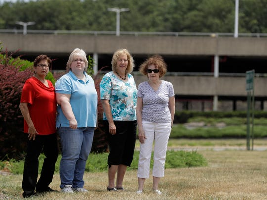 (From left) Barbara Denegar, Evelyn Guerra, Sara Breslow and Judy Bretzger stand near the entrance to Monmouth Mall in Eatontown. The four women are the plaintiffs in a court case against Jared Kushner's family real estate company, which is trying to expand the mall and build an apartment complex. The residents say they're upset because the complex encroaches onto their backyards and it will bring unwanted traffic and noise to the town.