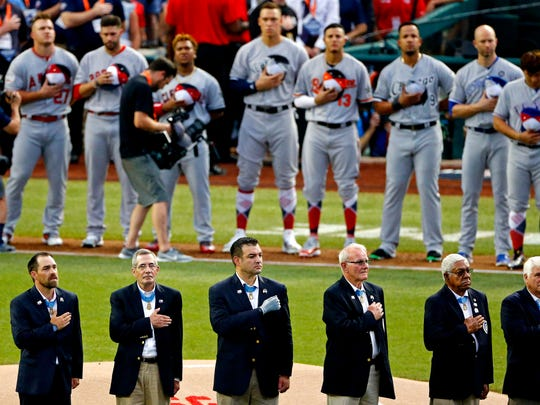 Medal of Honor recipients stand for the national anthem