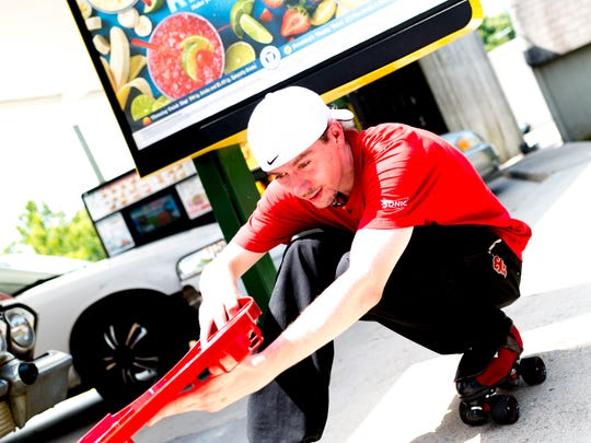 Carhop James Moffet skates around the parking lot at Sonic at 3307 N. Broadway in Knoxville on July 19.