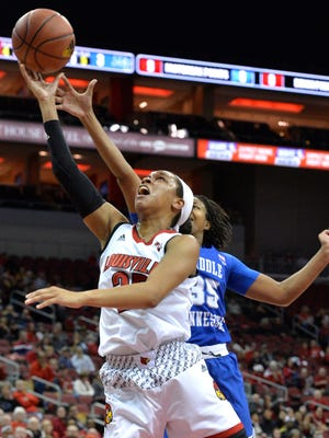 Louisville guard Asia Durr (25) shoots ahead of the defense of Middle Tennessee forward Charity Savage (35) during the first half of an NCAA college basketball game Saturday, Dec. 9, 2017, in Louisville, Ky. (AP Photo/Timothy D. Easley)