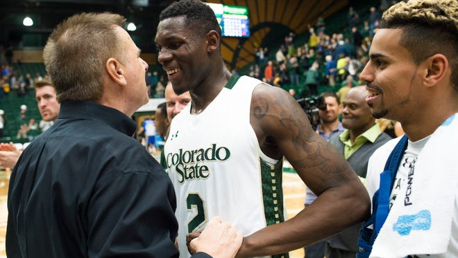 CSU coach Larry Eustachy celebrates with forward Emmanuel Omogbo after a 74-66 win over San Jose State at Moby Arena Wednesday, January 27, 2016.