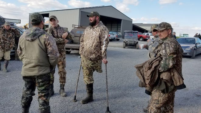 Veterans talk to Brig. Gen. John Novalis (left) before returning to an annual hunt sponsored by the Wounded Warrior Project and Warrior Initiative at Grassy Lake Hunting Club on Nov. 30, 2016 near Ware, Ill.