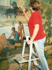 Artist Barbara Boedecker works to preserve and repair the mural at SCHRC.