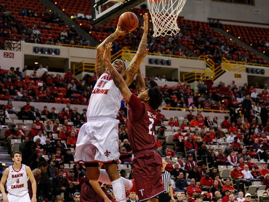 UL's Shawn Long, shown here taking the ball to the