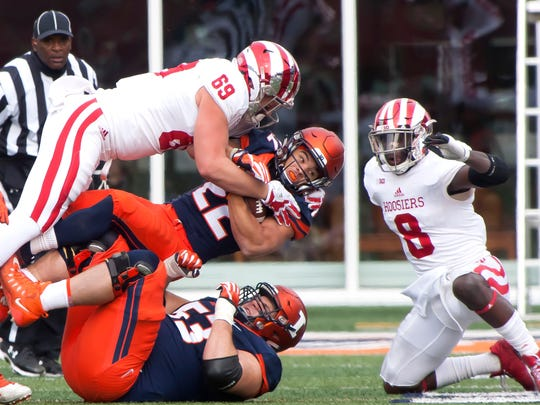 Indiana Hoosiers defensive lineman Gavin Everett (69) tackles Illinois Fighting Illini running back Kendrick Foster (22) during the second quarter at Memorial Stadium.