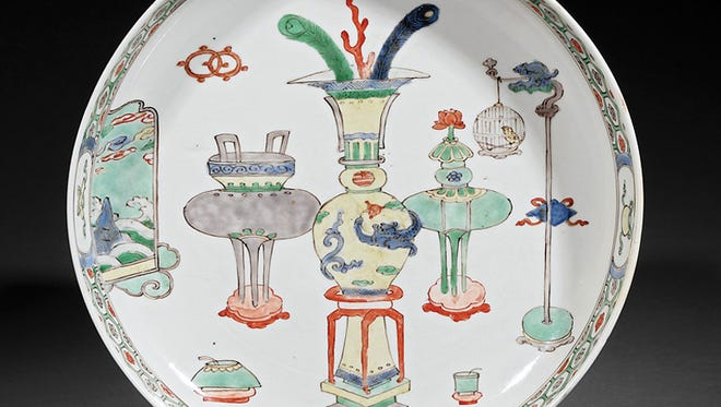Dinnerware that pictures household objects or furnishings is not a new idea. The Chinese plate showing furniture auctioned for over $2,000.