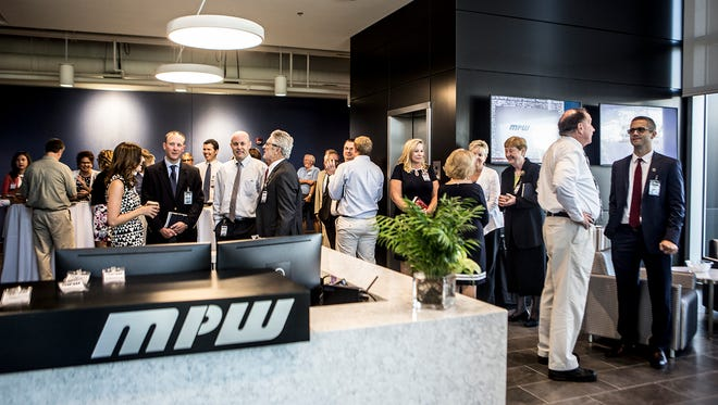 MPW Indistrial Services opened its new engineering and technology center to the public Wednesday at its 46-acre headquarters on Ohio 37, just south of U.S. 40.