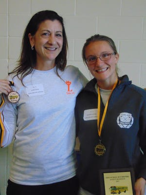 Loveland School bus drivers Lorie Stulz and Rachel Patton proudly display their medals and plaque as winners in the regional School Bus Driver ROAD-E-O competition held in April.