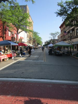 The Downtown Fond du Lac Farmers Market as it opens on the morning of July 15.