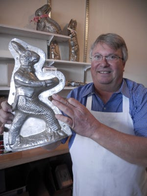 Third-generation confectioner Jim Niemann holds an Easter candy mold in his family's shop, Niemann Candies, in Wauwatosa.