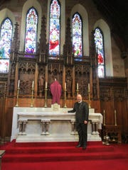 The Very Rev. C. Patrick Perkins stands at the High Altar of the Cathedral Church of St. Paul the Apostle on Feb. 27.