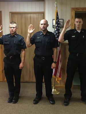 Three new police officers were sworn in during the Galion City Council meeting July 11. L to R: Jonathan Patton, Brandon Grant and Austin Chaplin.