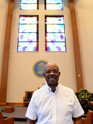 The Rev. Melvin T. Jones stands inside the chapel of Union Missionary Baptist Church. Jones is celebrating his 30th year at the church.