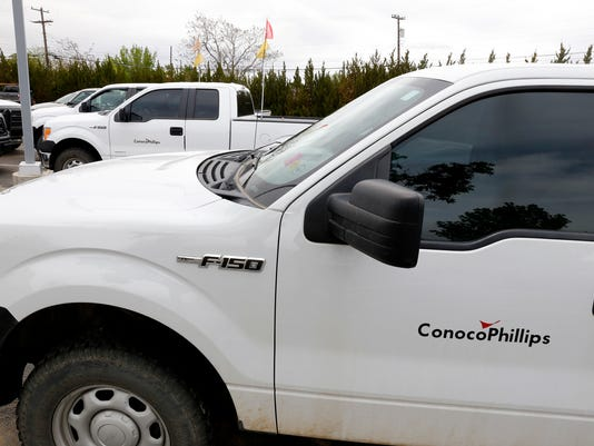 ConocoPhillips pick-up trucks are seen on May 15 at ConocoPhillips building in Farmington.