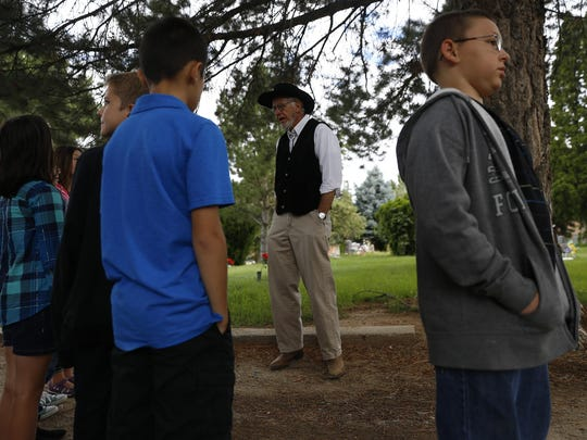 Bob Lehmer, center, tells the story of Joseph Wheeler during a dress rehearsal Friday for Dining with the Dead at Greenlawn Cemetery in Farmington.