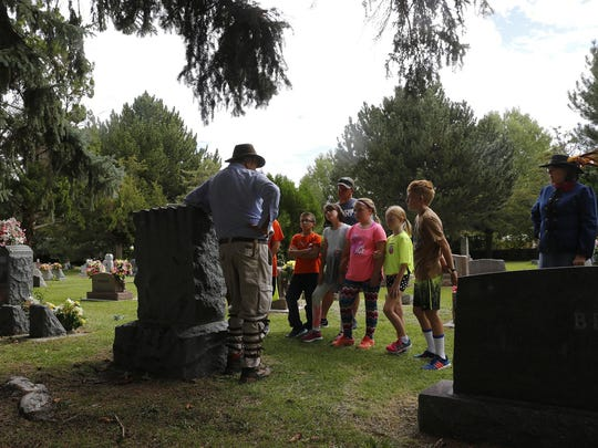 Doug Dykeman gives a presentation on local archaeologist Earl Morris during a dress rehearsal on Friday for Dining with the Dead at Greenlawn Cemetery in Farmington.