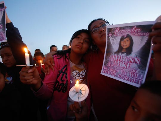 Klandre Willie, left, and her mother, Jaycelyn Blackie, participate in a candlelight vigil for Ashlynne Mike on May 4 at the San Juan Chapter House in Lower Fruitland.