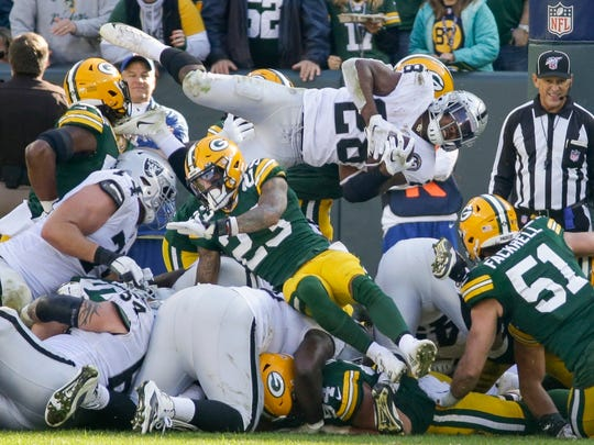 Oakland Raiders' Josh Jacobs is stopped on a fourth down run during the second half of an NFL football game against the Green Bay Packers Sunday, Oct. 20, 2019, in Green Bay, Wis. (AP Photo/Mike Roemer)